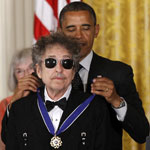 Bob Dylan receiving the presidential Medal of Freedom from US president Barack Obama at the White House