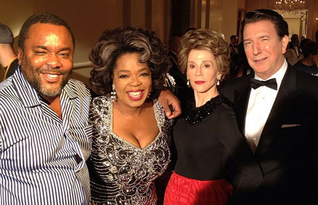 Jane Fonda and Alan Rickman as the Reagans, with Oprah Winfrey