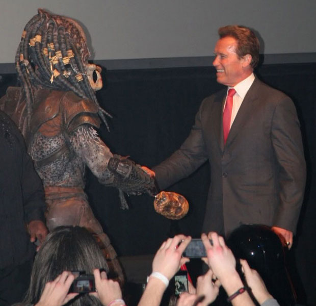Arnold Schwarzenegger hakes hands with The Predator