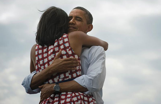 Barack Obama hugs Michelle following victory. Photograph sets Facebook record for most likes ever.