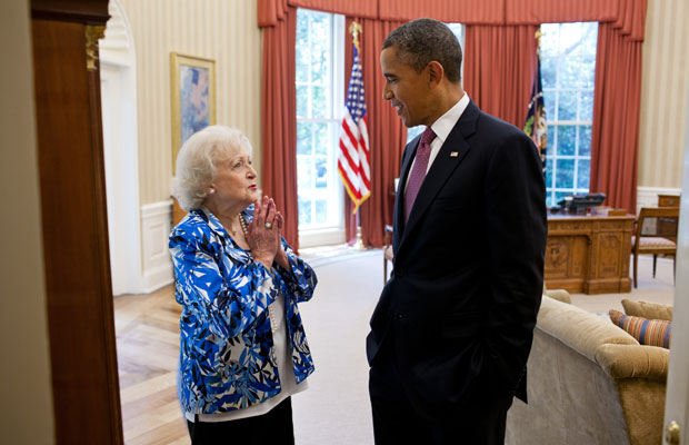 Barack Obama meeting with actress Betty White in the Oval Office