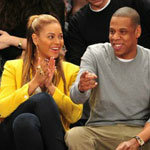 Beyonce and Jay Z take in a game