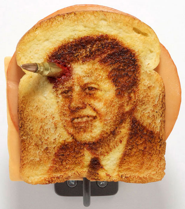 Toast art featuring JFK with bloody bullet in his head