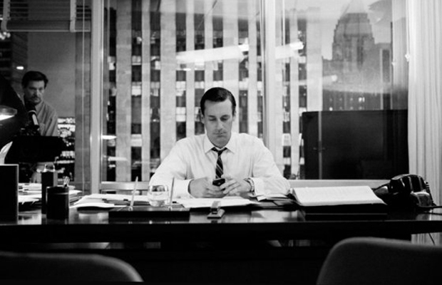 Don Draper using his iPhone