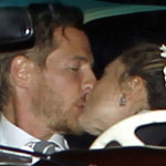 Drew Barrymore and Will Kopelman having a wedding kiss in their car