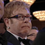 Elton John looking sad at the 2012 Golden globe Awards