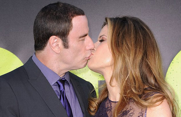 John Travolta kissing his wife Kelly Preston at the Savages Premiere in LA in July 2012