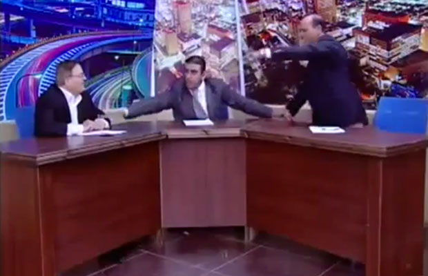 Jordanian MP pulling a gun during live television debate