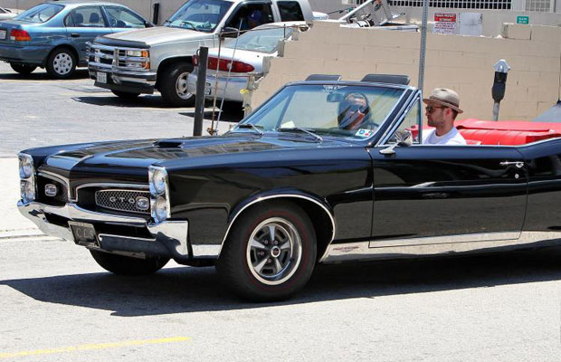 Justin Timberlake driving a black classic convertible, a vintage 1960s Pontiac GTO, in LA in May 2012