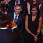 Mike Myers performing for the Obamas