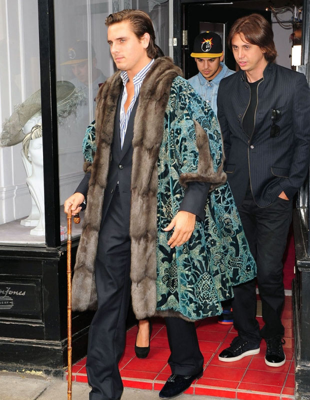 Scott Disick channelling Henry VIII in a fur coat and a wooden cane in London with Rob Kardashian and Jonathan Cheban