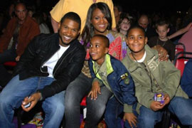 Usher and Tameka with son Kyle Glover
